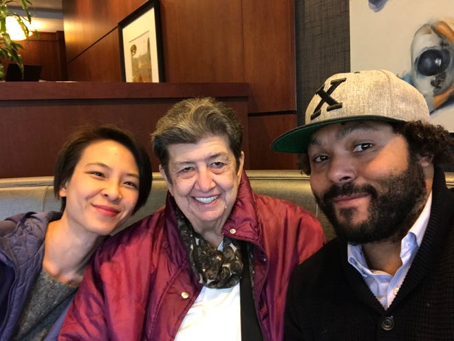 Cathy Woods, 70, poses for a photo taken in April 2019. She is seen sitting with two of her attorneys, Elizabeth Wang and David B. Owens, both with Loevy & Loevy, a civil rights law firm.