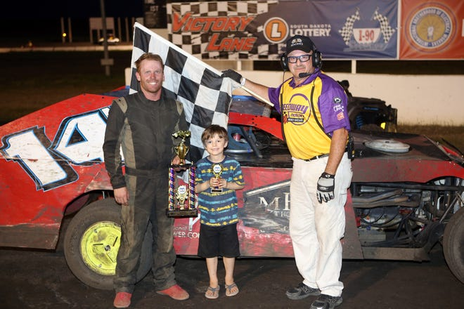Baltic resident Skyelar DeVaney (left) accepts the first place trophy in Victory Lane at I 90 Speedway in Hartford on July 4, 2020.