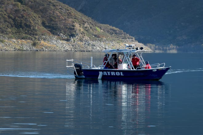 Search and Rescue teams use boats to look along the northern shore of Lake Piru on Thursday, July 9, 2020, for actress Naya Rivera. The 'Glee' actress went missing after renting a boat with her 4-year-old son at Lake Piru on Wednesday.