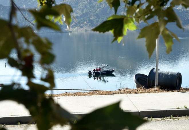 """Search-and-rescue teams use boats to look along the northern shore of Lake Piru on Thursday, July 9, 2020, for actress Naya Rivera. The """"Glee"""" actress went missing after renting a boat with her 4-year-old son at Lake Piru on Wednesday."""
