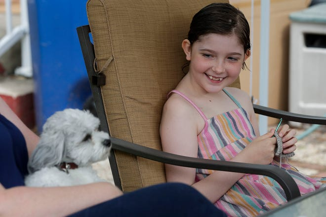 Claire Hornby, 10, smiles at her dog, Freddy, during an interview with her mother, Kirsten Hornby, on Wednesday, July 1, 2020, at their home in Wausau, Wis. Claire was diagnosed with an incurable form of brain cancer, diffuse intrinsic pontine glioma, in May 2019. Tork Mason/USA TODAY NETWORK-Wisconsin