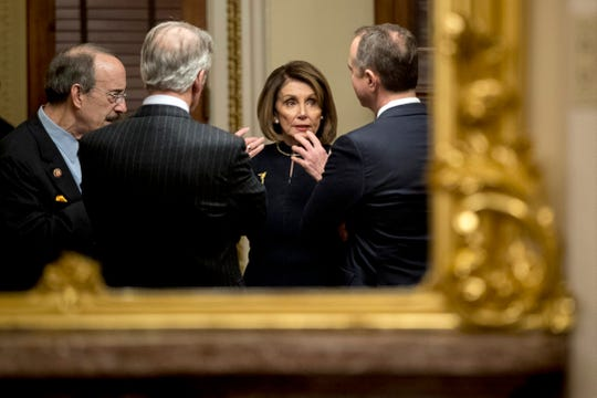 House Speaker Nancy Pelosi of Calif., center, speaks with House Intelligence Committee Chairman Adam Schiff, D-Calif., right, House Foreign Affairs Committee Chairman Eliot Engel, D-N.Y., left, and House Ways and Means Committee Chairman Richard Neal, D-Mass., second from left, in a private room just off the House floor after the House votes to impeach President Donald Trump, Wednesday, Dec. 18, 2019, on Capitol Hill in Washington.