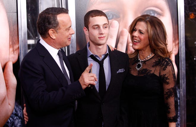 "Tom Hanks and Rita Wilson with their son Chet Hanks at the premiere of ""Extremely Loud & Incredibly Close"" in 2011."