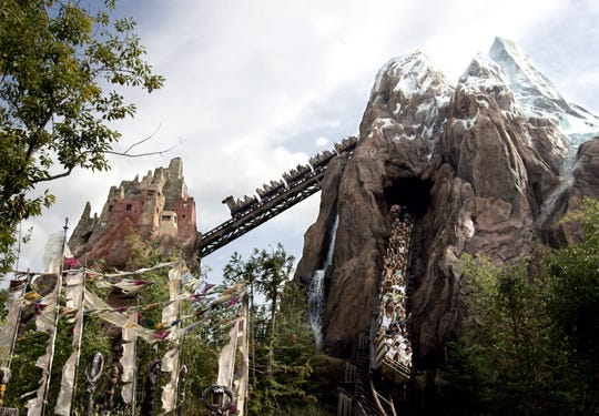 Visitors experience the Expedition Everest roller coaster at Walt Disney World Animal Kingdom in Lake Buena Vista, Florida.