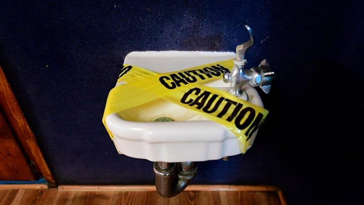 A water fountain is covered with tape and inaccessible as per coronavirus guidelines, during summer school sessions at Happy Day School in Monterey Park, California on July 9, 2020. - California Governor Gavin Newsom says the reopening of California schools for the coming school year will be based on safety and not pressure from President Donald Trump as California sets records for one-day increases in COVID-19 cases.