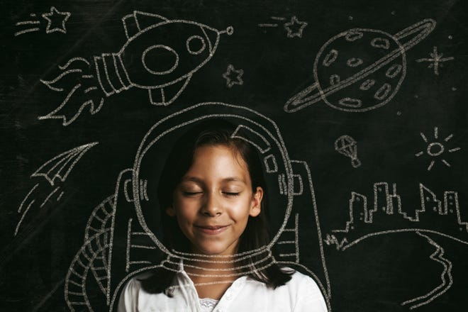 A young girl dreams of space travel