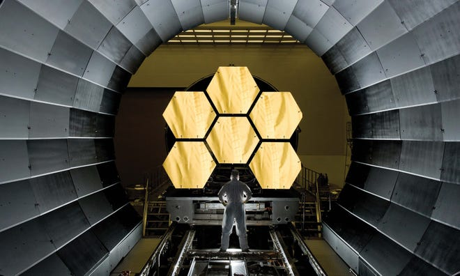 This photo shows primary mirror segments for NASA's James Webb Space Telescope being prepped for final cryogenic testing. L3Harris Technologies Inc. integrated telescope components and tested the telescope in a cryogenic vacuum chamber at Johnson Space Center.
