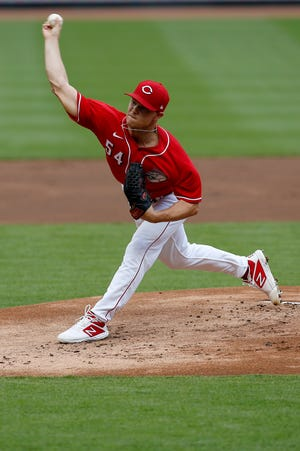 Cincinnati Reds starting pitcher Sonny Gray (54) delivers a pitch during an intrasquad scrimmage game of preseason training at Great American Ball Park in downtown Cincinnati on Thursday, July 9, 2020.