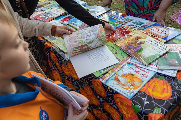 A student looks at books at the Candy of Mind table.