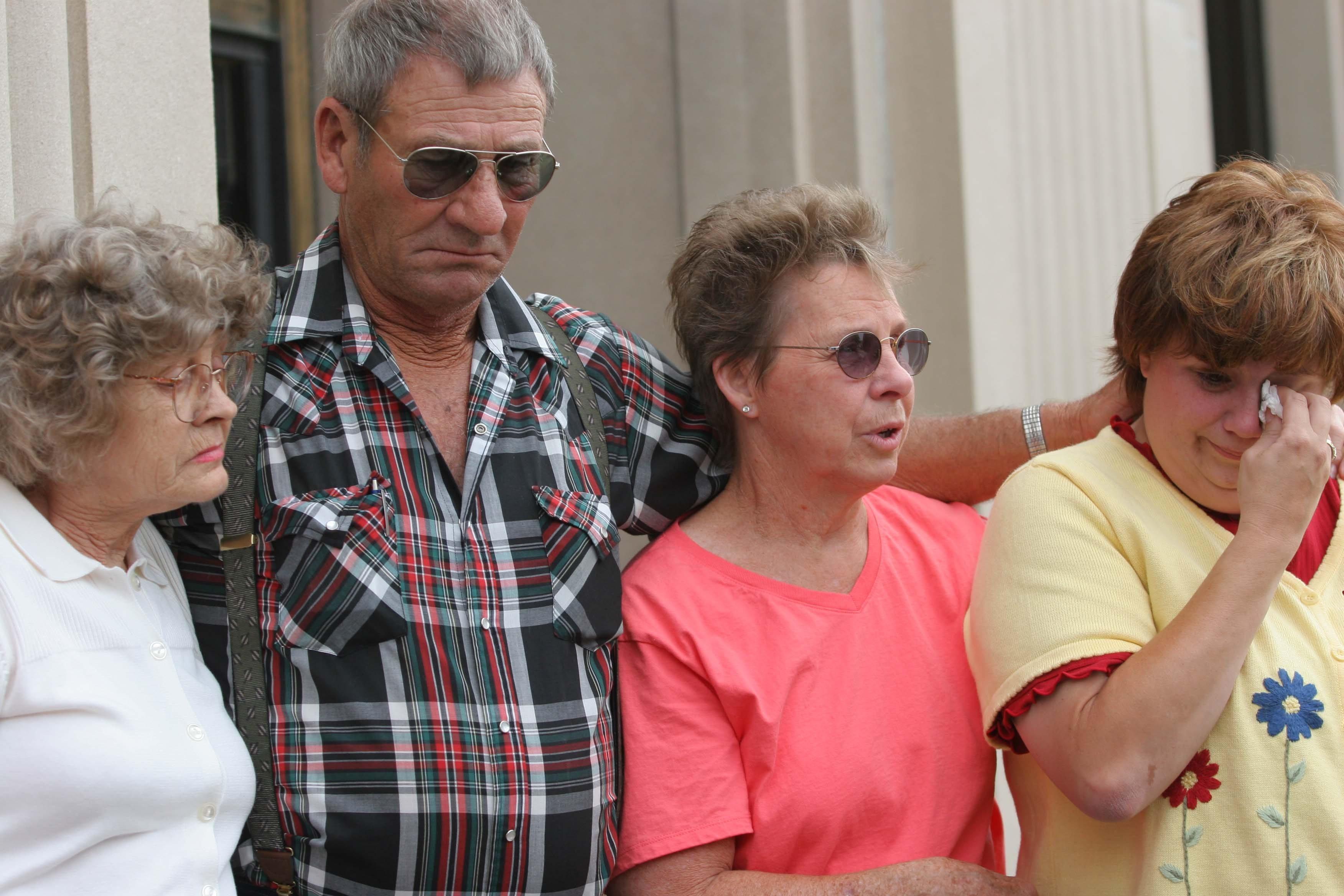JoAnn DeGeus, Ed DeGeus, Marge Milbrath and Connie Milbrath speak to the media outside the Federal Courthouse in Sioux City, Iowa, Tuesday, June 21, 2005.