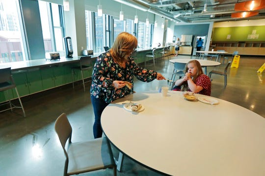 Connie Wade, left, prepares to eat lunch with her daughter Emilyanne, 12, Wednesday, June 17, 2020, at Mary's Place, a family homeless shelter located inside an Amazon corporate building on the tech giant's Seattle campus.