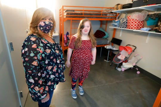Connie Wade, left, poses for a photo with her daughter Emilyanne, 12, Wednesday, June 17, 2020, in their room at Mary's Place, a family homeless shelter located inside an Amazon corporate building on the tech giant's Seattle campus. The facility is home to the Popsicle Place shelter program, an initiative to address the needs of homeless children with life-threatening health conditions.