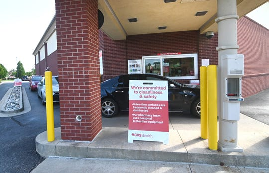 Motorists go through a COVID-19 testing line at a CVS in Troy on Friday, July 10, 2020.
