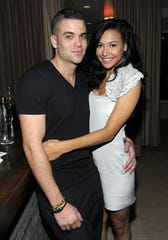 Actor Mark Salling and actress Naya Rivera attend the celebration of Glee's Golden Globe nominations with InStyle and 20th Century Fox held at Sunset Tower on Jan. 9, 2010 in West Hollywood, California.