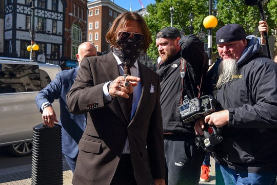 Johnny Depp arrives at the High Court in London, Friday July 10, 2020.