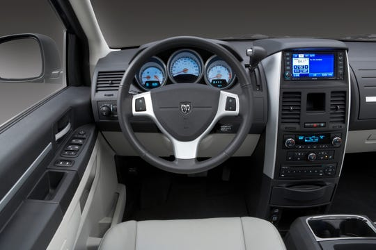 The plastic emblems on the steering wheels of older Fiat Chrysler minivans and SUVs, including the 2010 Dodge Caravan, shown, can loosen and become projectiles if the driver's air bag is inflated in a crash.
