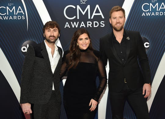 "Dave Haywood, left, Hillary Scott and Charles Kelley, of Lady A, formerly Lady Antebellum, arrive at the 52nd annual CMA Awards in Nashville, Tenn. The Grammy-winning country group, which dropped the word ""Antebellum"" from their name because of the word's ties to slavery, has filed a lawsuit against a Black singer who has used the stage name for years. The vocal group filed the lawsuit on Wednesday in federal court in Nashville after negotiations with Anita White broke down in recent weeks."
