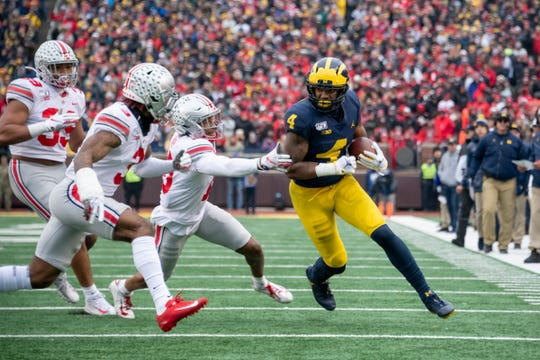 Michigan wide receiver Nico Collins is chased by Ohio State players during the 2019 game in Ann Arbor.