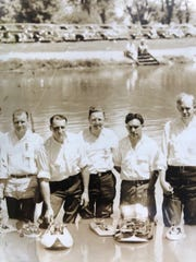 Charter members of the Detroit Model Power Boat Club on  July 4, 1940 at the Belle Isle pond.
