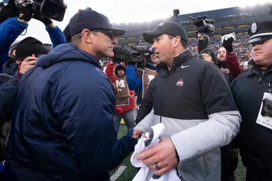 Michigan's Jim Harbaugh and Ohio State's Ryan Day shake hands after the Buckeyes' win in 2019.