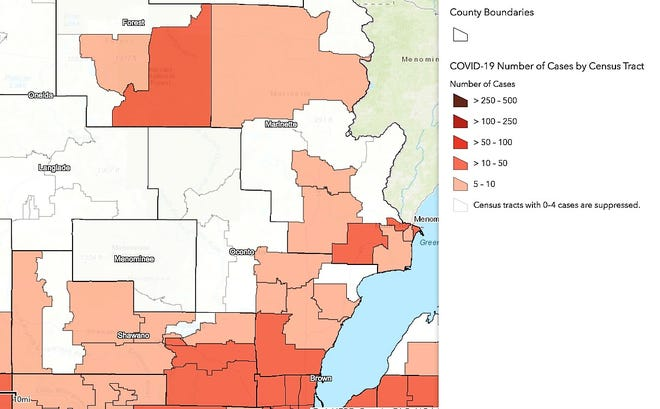 Census tracts in northeast Wisconsin counties are seen in this map, shaded to show the range of the number of coronavirus cases that have emerged in each area. Areas that are white have had less than five cases. The light tan indicates 5-10 cases, while the next darkest seen in most other areas is 10-50 cases.