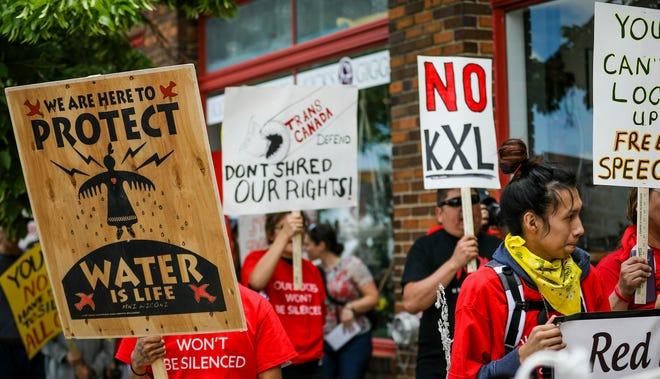 Protesters against the Keystone XL pipeline make their way to the Federal Courthouse in Rapid City, South Dakota, in 2019.