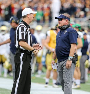 Notre Dame head coach Brian Kelly talks to an official during the Camping World Bowl in Orlando, Fla. on Dec. 28, 2019.