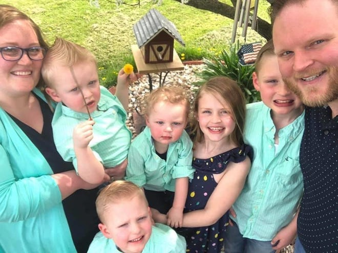 Jennifer, Jack, Ady, Eli, Cam, Kai and Zachary Overy (far right). Zachary Overy was deeply loved by his community and was known to light up any room he entered.
