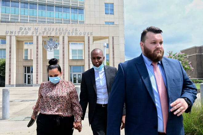 Moss Point Mayor Mario King, center, and his wife Natasha R. King leave the federal courthouse in Gulfport, Miss., with their attorney Tyler Cox on July 10, 2020.