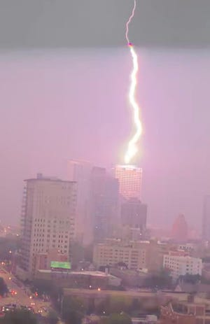 Lightning strikes the US Bank building in downtown Milwaukee during Thursday night's thunderstorm.