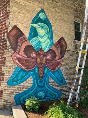 """""""Hunter's Prayer,"""" at Appleton Avenue and Main Street, is the second mural to be completed in the Menomonee Falls BID mural project. He shows the importance of nature in the mural. There will be nine murals completed by the end of the summer."""