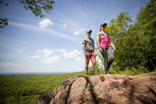 A couple takes a hike in the Chequamegon Nicolet National Forest, which includes more than 1.5 million acres.