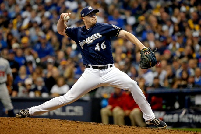 Reliever Corey Knebel, who is returning from Tommy John surgery on his right elbow, threw an inning during the Brewers' intrasquad scrimmage Friday.