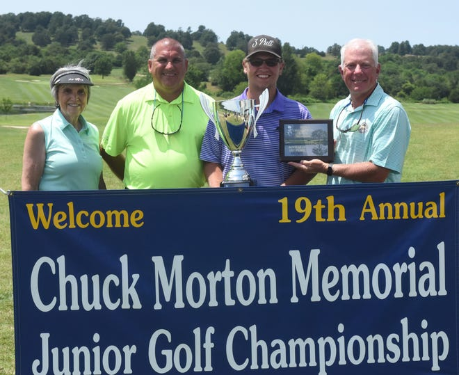 Dalton McGinnis won the Chuck Morton Junior Golf Tournament on Friday at Big Creek Golf & Country Club.  Pictured are: (from left) Beverly Morton, Mark Morton, McGinnis, and Big Creek professional Todd Dunnaway.
