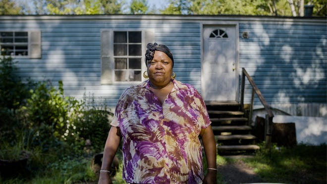 Pamela Rush photographed in front of her mobile home in Tyler, Alabama in 2018. Ms. Rush died of COVID-19 on July 3.