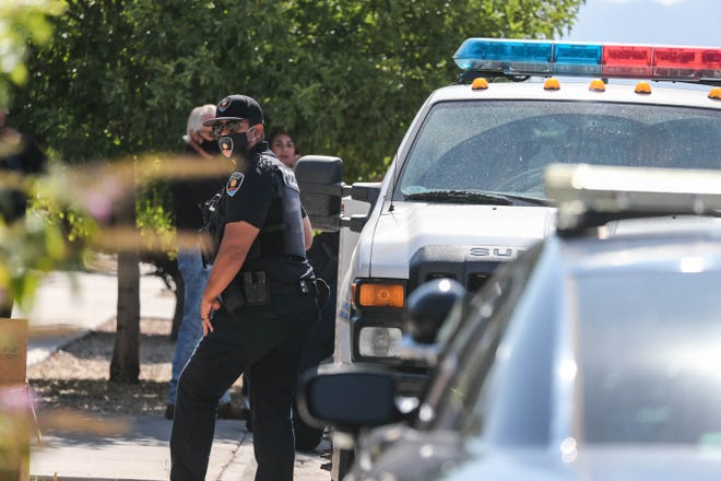 Las Cruces police investigate a home on Santa Sabina Avenue after a shooting at a house party injured a teen in Las Cruces on Friday, July 10, 2020.