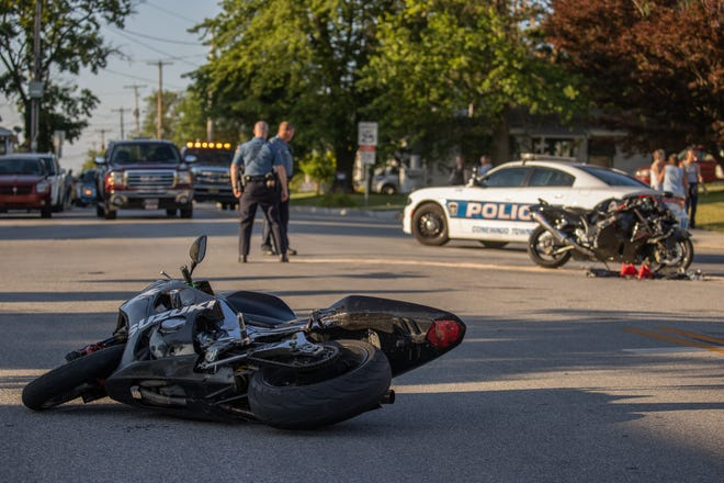 Police investigate at the scene of a crash between a motorcycle and an SUV at the intersection of Poplar and South Jefferson Streets, Thursday, July 9, 2020, in Conewago Township. The motorcyclist, a 20-year-old Hanover man, was flown to the hospital, and two patients were taken to the hospital by ground ambulance, including the female driver of the white SUV, who was in her 70s, according to investigating officer Kyle Freeman. Another motorcycle was damaged, but not by the crash itself, Freeman said.