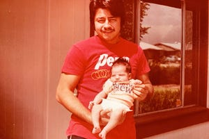 Mark Anthony Urquiza holds his daughter, Kristin Urquiza, in this undated family photo. Mark Anthony Urquiza, of Phoenix, died June 30, 2020, of COVID-19. He was 65.