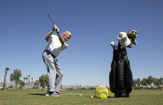 Gregg Clymer hits balls on the driving range at Tuscany Falls Country Club in Goodyear's PebbleCreek community.