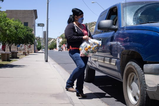 Christine Duarte, a town director, hands out lunches on June 30, 2020, at Veterans Park in Miami, Arizona. They are packing 184 lunches every weekday. On Fridays, the kids get extra milk and snacks to help get them through the weekend.