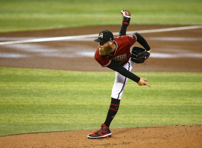 Jul 9, 2020; Phoenix, AZ, USA; Arizona Diamondbacks pitcher Archie Bradley throws during an instrasquad game at summer camp workouts at Chase Field. Mandatory Credit: Rob Schumacher/The Arizona Republic via USA TODAY NETWORK