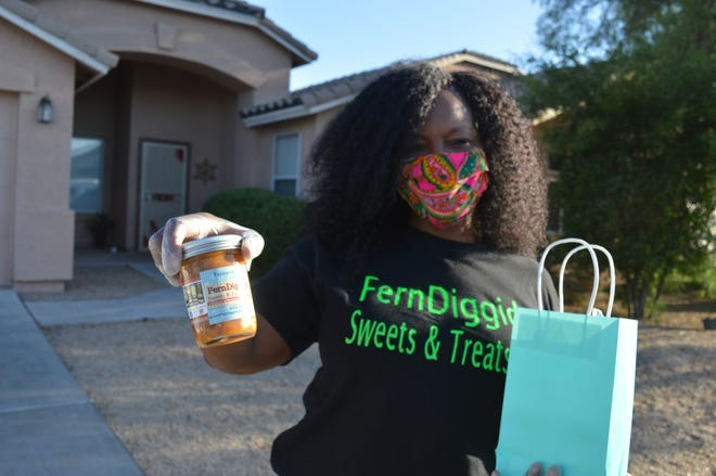 Fernanda Sayles, owner of FernDiggidy Sweets and Treats, shows off her peach cobbler in a jar on July 9, 2020. Sayles is a Phoenix Micro business Resiliency Grant recipient.