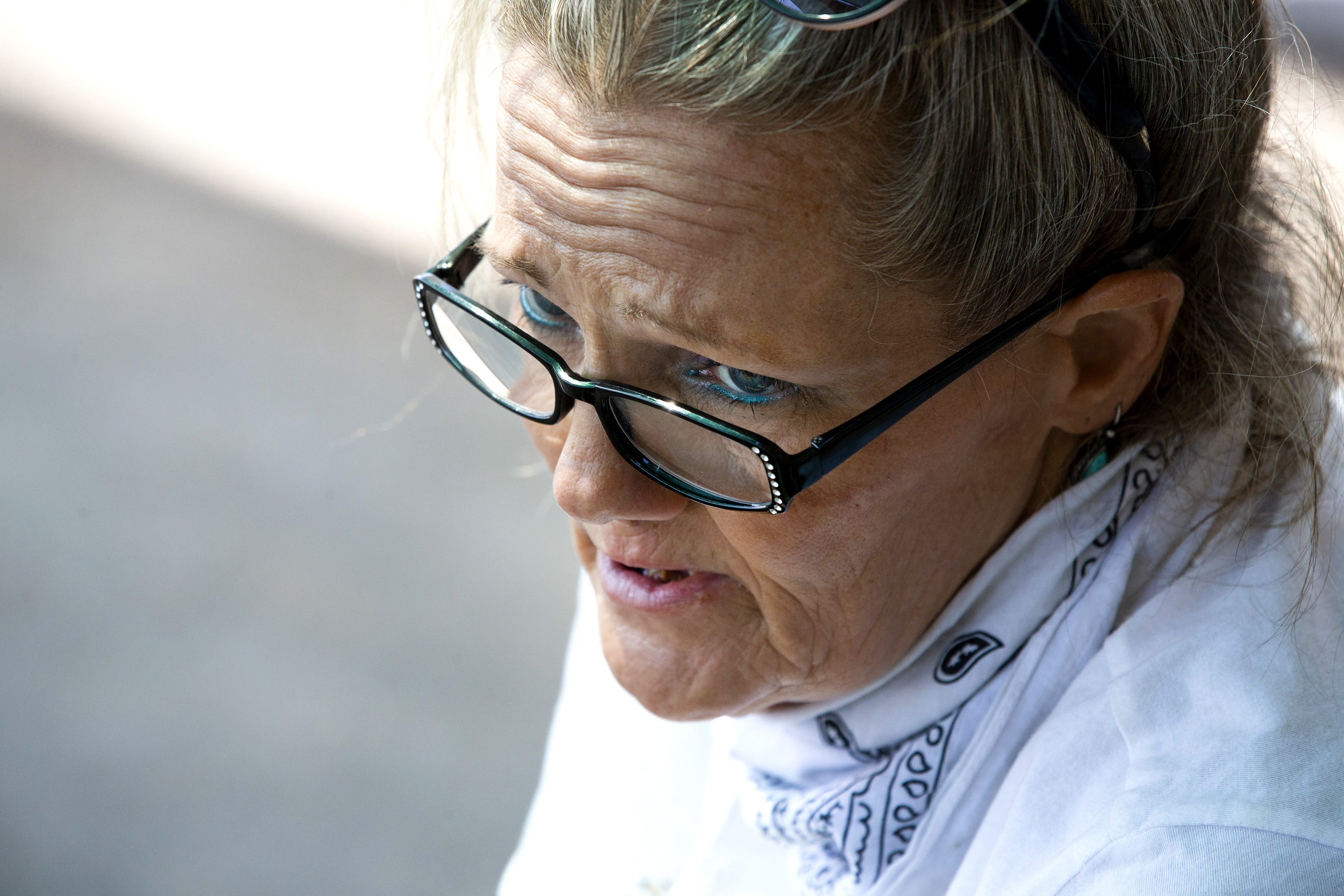 """Darlene Carchedi (seen June 30, 2020, at the Andre House in Phoenix) says she is not worried about catching COVID-19 on the streets. """"I'm not afraid much of anything,"""" she says. """"For 54 years God's taken care of me."""""""