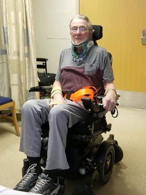 Ed Mainguy in his wheelchair just after a traffic crash two years ago that broke his neck and injured his shoulder.