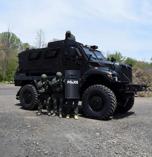 File - The $865,000 Mine Resistant Ambush Protected (MRAP) vehicle bought in February of 2016 for the the South Central Emergency Response Team, a Bucks County group of officers from departments in 14 municipalities. The federal 1033 program administered through the Defense Logistics Agency provides surplus military equipment for the cost of shipping and other fees to local and state law enforcement agencies.