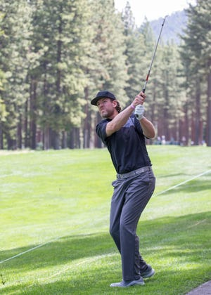 Carson Palmer swings during the ACC Golf Tournament at Edgewood Tahoe Golf Course in South Lake Tahoe on Friday.