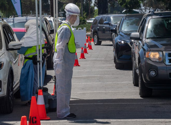 Christopher Henderson, a Natividad helped perform over a hundred COVID-19 tests during the free Coronavirus drive-thru testing site in King City, Calif., on Thursday, July 9, 2020.