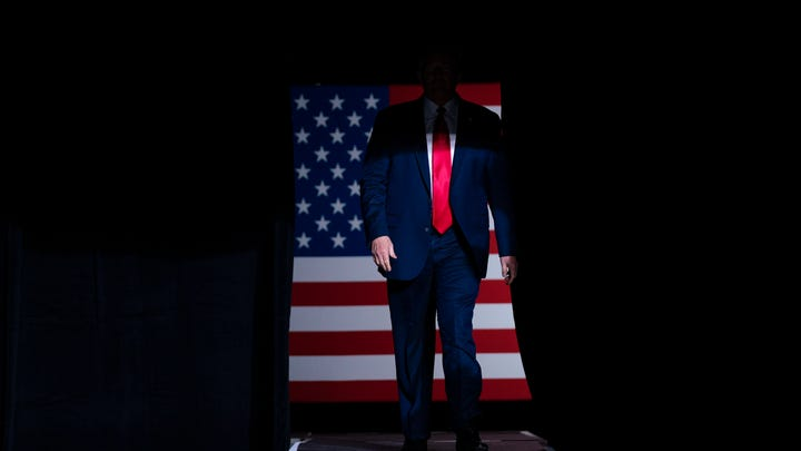 President Donald Trump arrives on stage to speak at a campaign in Tulsa, Oklahoma, on June 20.