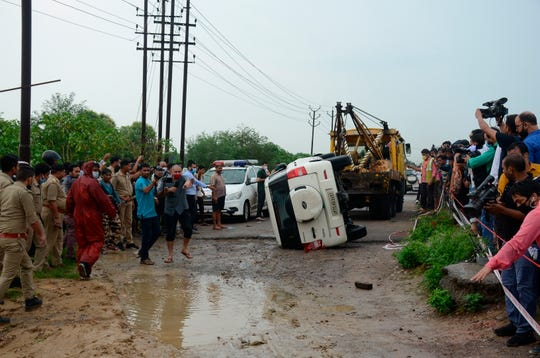 The overturned vehicle that was carrying top criminal Vikas Dubey is towed away near Kanpur, India, Friday, July 10, 2020. The top suspect in dozens of crimes, including the killings of eight police officers last week, was fatally shot Friday in police custody while allegedly trying to flee, officials said.