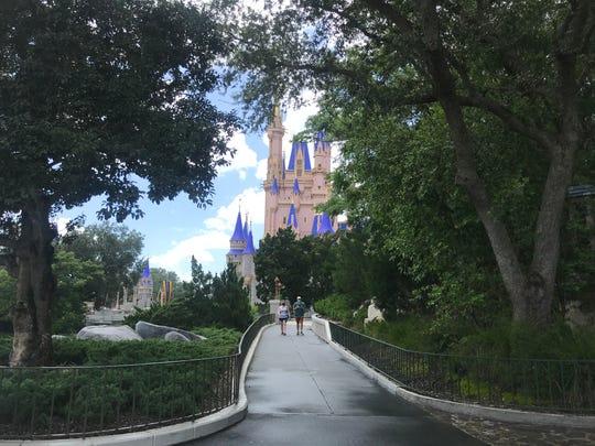 Coronavirus updates: More than 66K new cases; Walt Disney World reopens amid surge in Florida; Trump wears mask